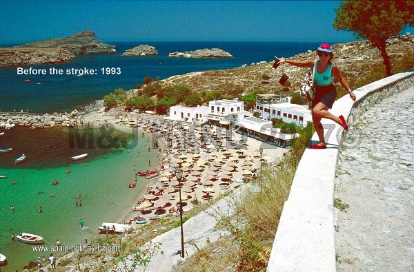 a careful pose; pallas beach, lindos; rhodes, greece