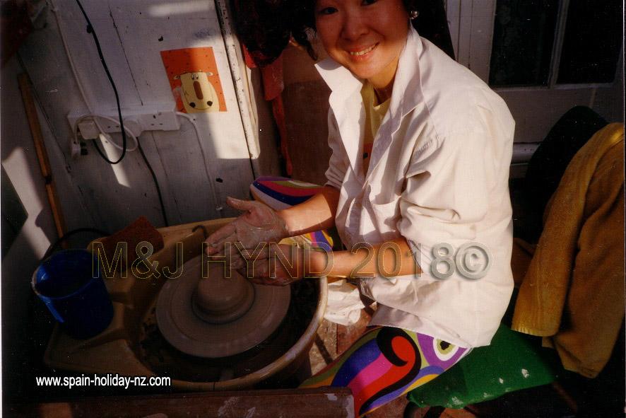 Pre-stroke, throwing on a potters wheel