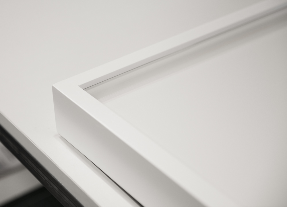 Detail of smooth lacquer finish used on the frames throughout the exhibition