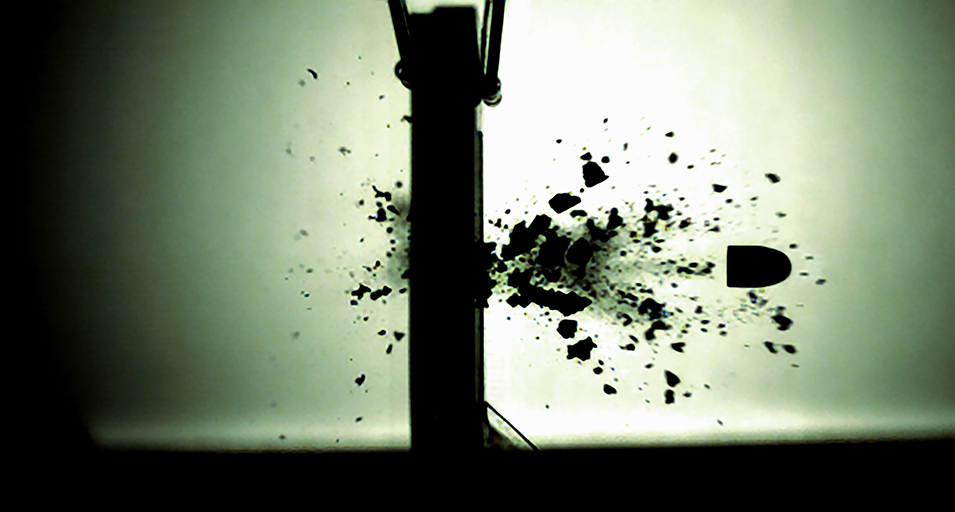 When a bullet impacts its target, the majority of the fragments generated spatter forward in the direction of the bullet. However, there is also a smaller portion of fragmentation at the entrance site, travelling back towards the shooter. This retrograde spatter is called backspatter. Due to its reverse-directionality, backspatter can provide important information to solve crimes that cannot be found in normal forward spatter. This still shot of a bullet penetrating a bone simulant captures both the forward and backspatter being generated by a 9 mm full metal jacket bullet, which has a muzzle speed of 350 metres-per-second.