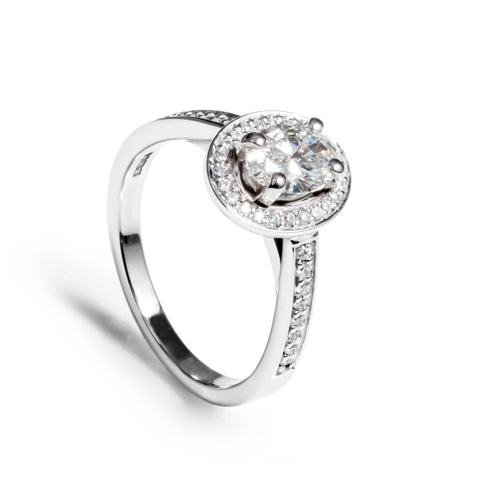 Oval cut halo diamond and 18ct white gold ring (VS2, E, 0.9ct)
