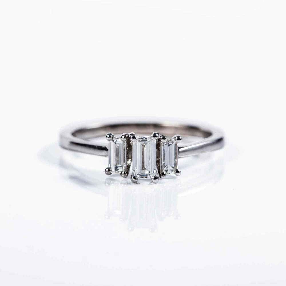 Baguette cut trilogy , 18ct white gold ring.