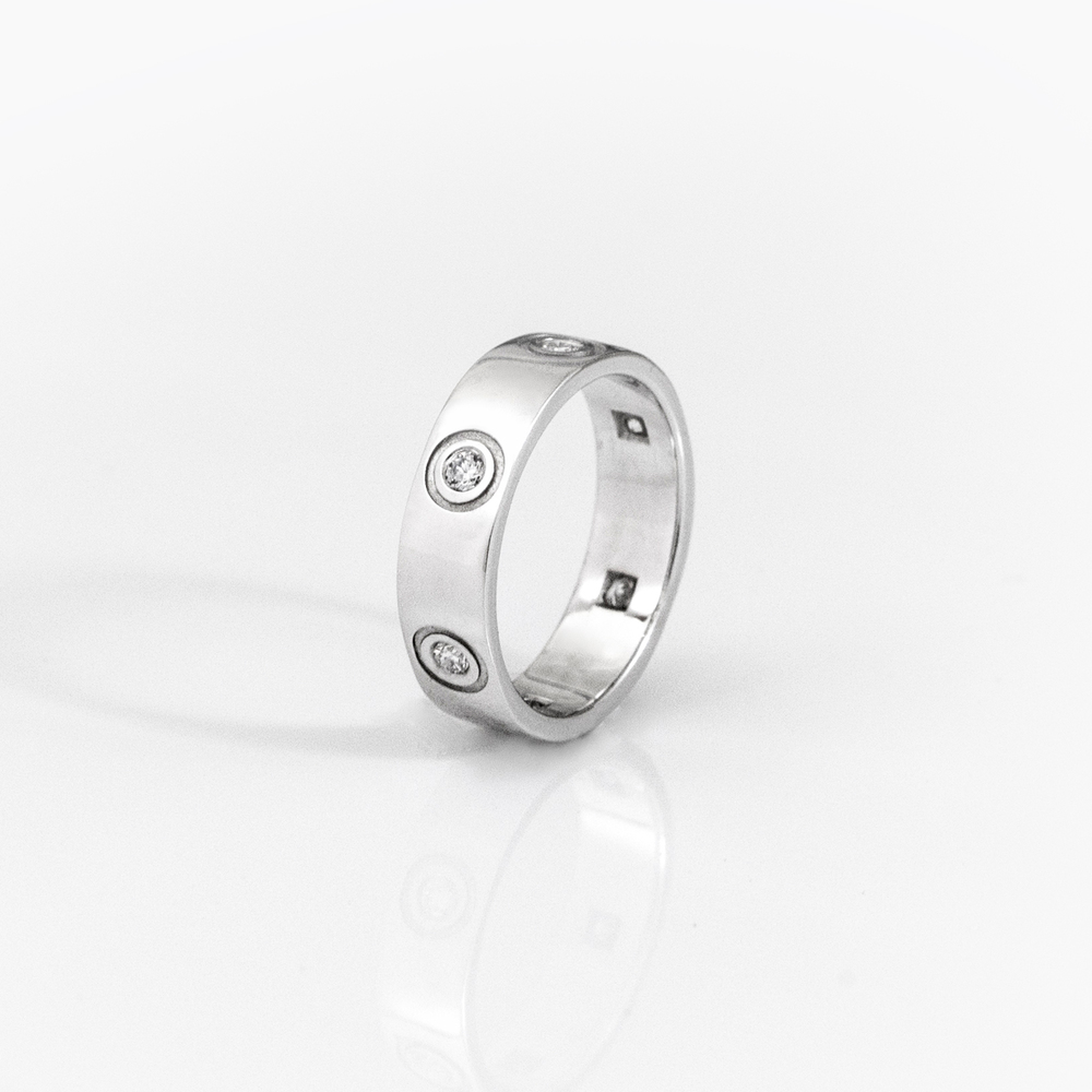 18ct white gold, with 6 flush set diamonds.