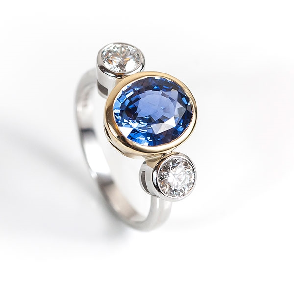 Oval sapphire and diamond trilogy (3.15ct sapphire, 0.8ct diamond, Platinum and 18ct gold)