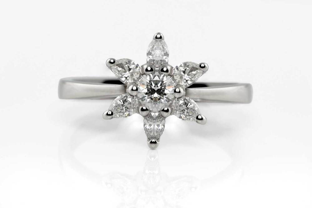 Diamond star cluster engagement ring