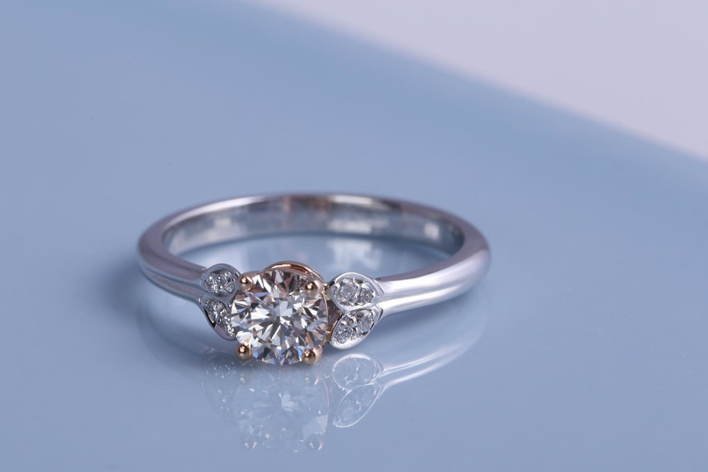 Rose gold and Platinum engagement ring. Made in Hertfordshire by James Veale Jewellery.