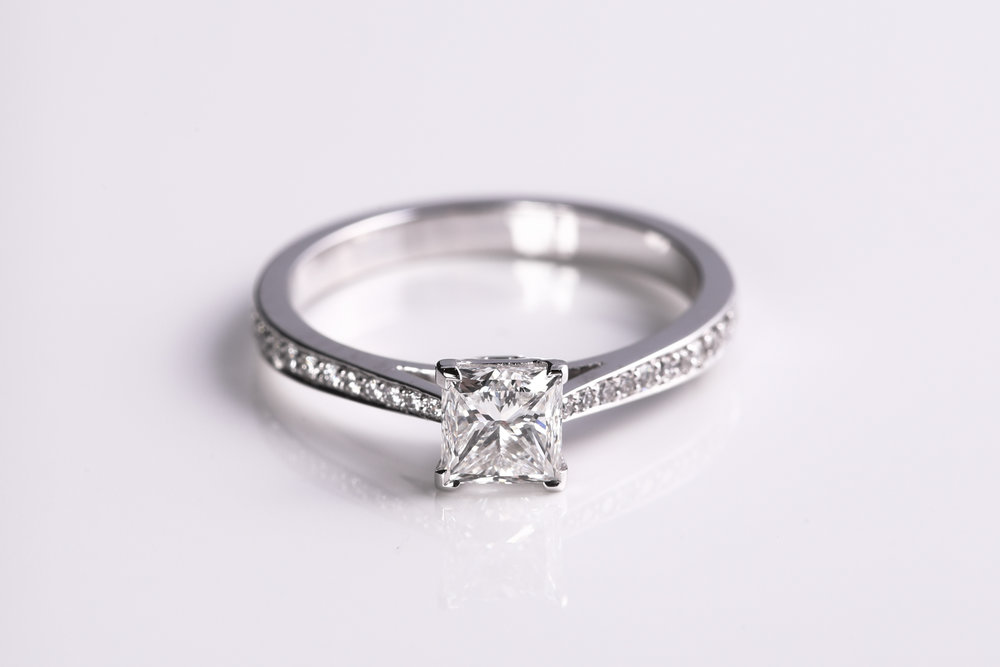 Platinum, Princess cut diamond solitaire with Pavé shoulders - Made in Hitchin by James Veale Jewellery