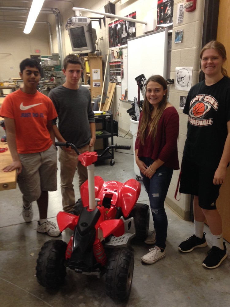 Normal Community High School students with the modified vehicle they designed and engineered.