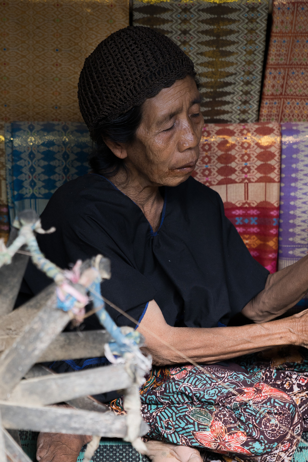One of the villagers showing us how to weave ikat cloth.