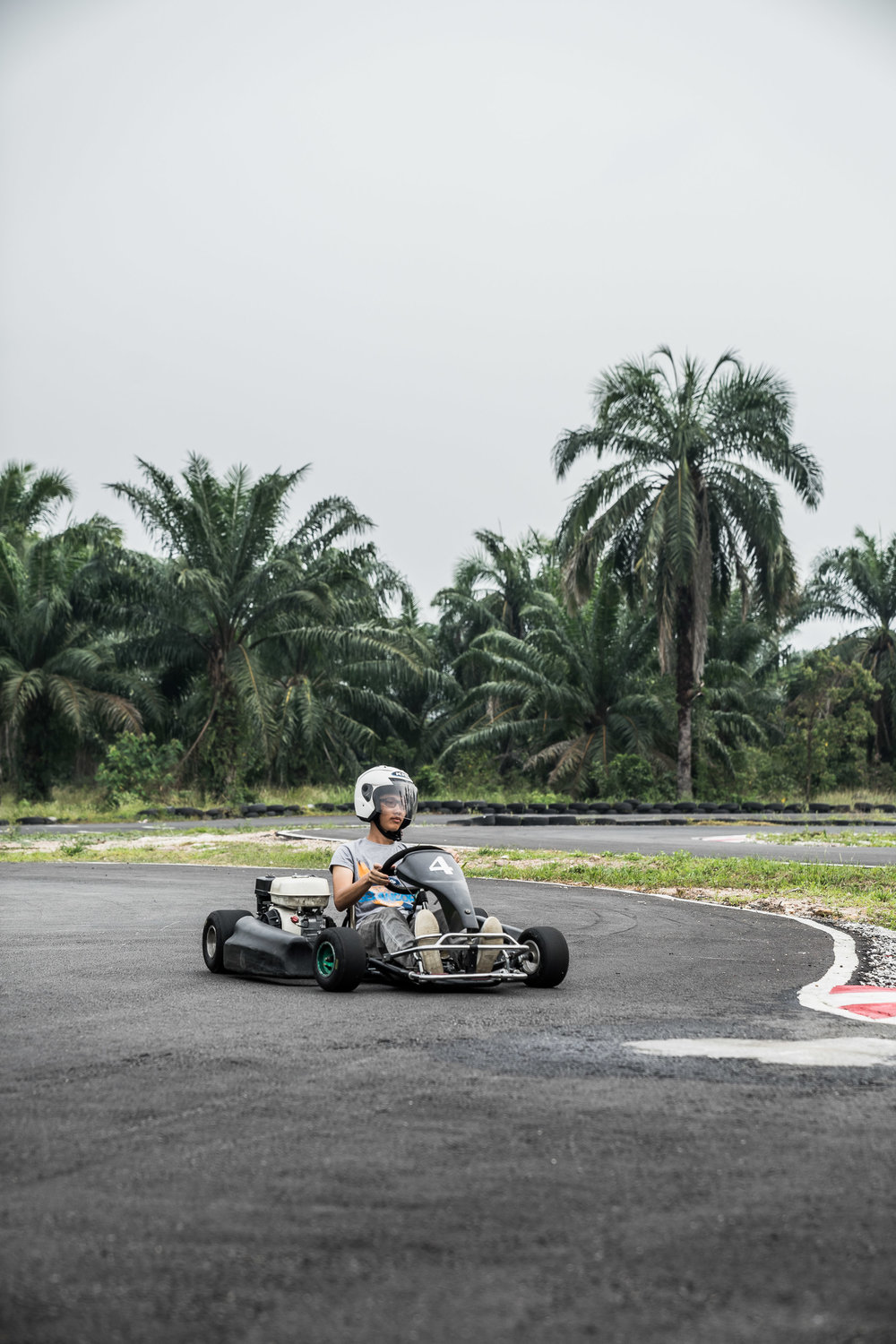 Hasif driving around the track.