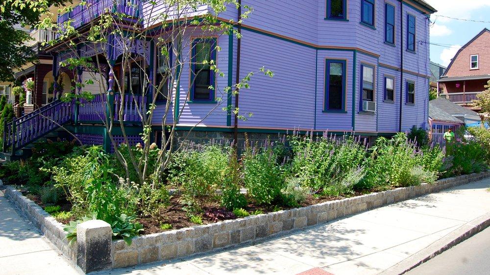 Scope Of Work:  - Custom Design  - Grading and Demolition  - Natural Stone Wall Installation  - Edible Garden/Flower Garden Installation  - Driveway Installation  - Arbor Installation