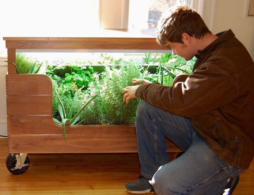 Scope Of Work:  - Custom Design  - Indoor Garden Construction  - Custom Metal Fabric Fabrication  - Custom Reclaimed Walnut Lumber Fabrication