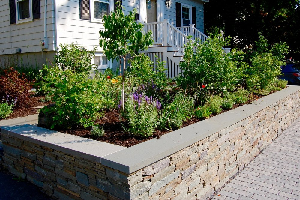 Scope Of Work:  - Custom Design  - Significant Grading and Demolition  - Permeable Paver Sidewalk and Driveway Installation  - Natural Stone Wall Installation  - Edible Garden Installation  - Steps Installation