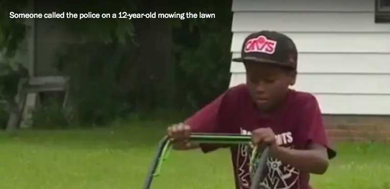 12-year-old Reggie Fields mowing the lawn © Washington Post
