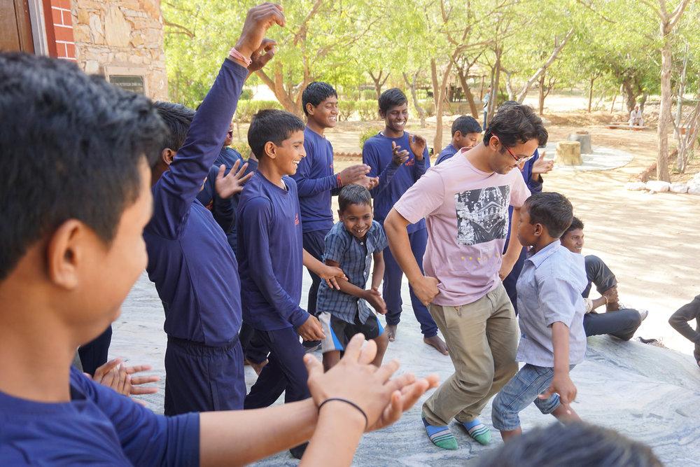 Kalpesh dancing with Rizwan © Sophia McCarron
