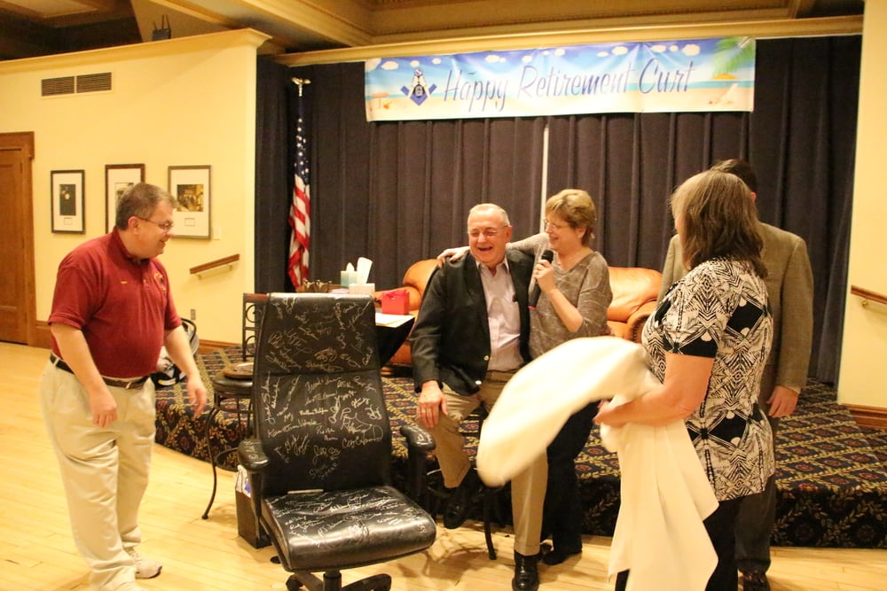 Presenting Curt with his office chair, signed by Masons