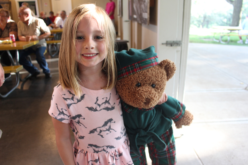 Andrew's daughter wins a teddy bear