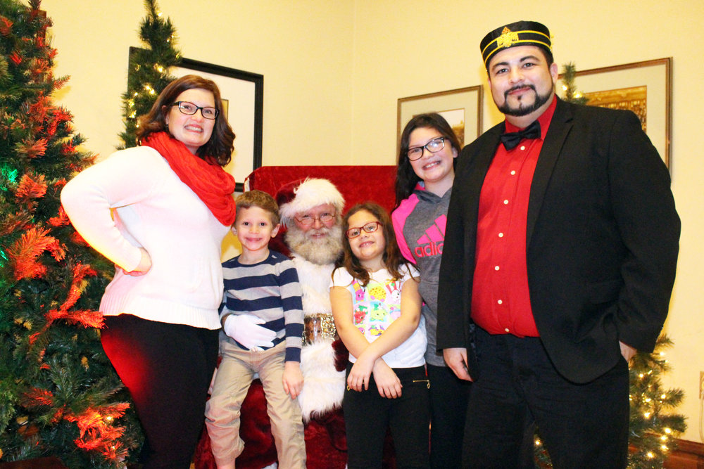 Glen and Nikki Lewis and kids with Santa.JPG