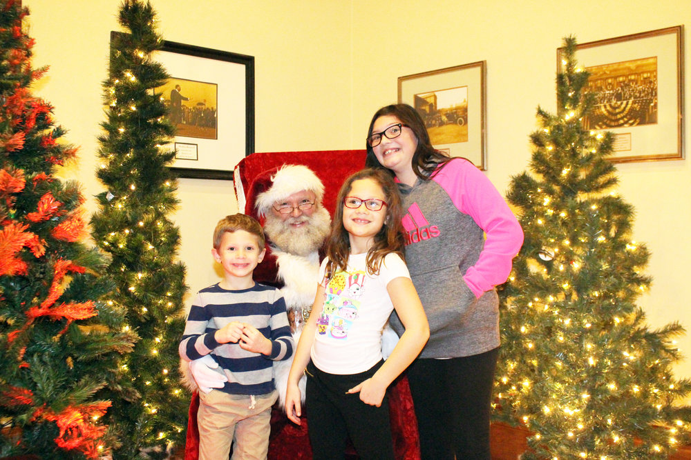 Glenn Lewis kids and Santa Claus.JPG