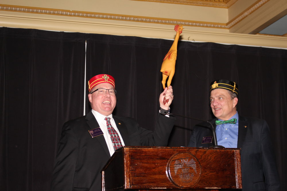 Mike Stuhr and Bill Kimme presenting rubber chicken.JPG