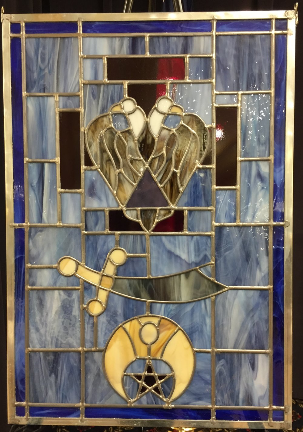 Beautiful stained glass window made by Scott Oglesby, 33° in honor of Jerome Given, 33° and reflecting his lifelong, active Scottish Rite and Shrine membership.