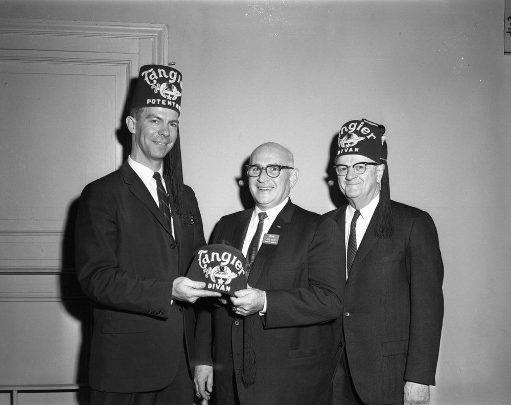 January 11 1963 OWH Potentate F. Jerome Given handing a Divan hat to Bob Silver while Walter Korisko watches..jpg