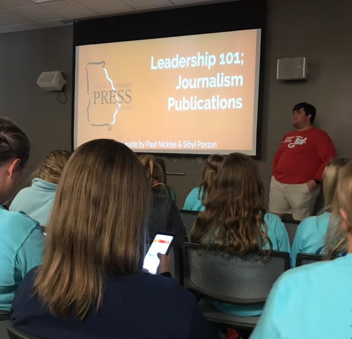 Paul Nickles, GSPA Student Advisory Board member, and Sibyl Poston, co-editors of Thompson High School's Archive yearbook, share tips and tricks for growing staffs during the GSPA Fall Conference Oct. 22, 2018, at the UGA Tate Student Center.