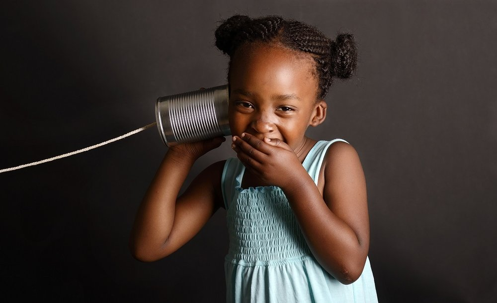 Girl_Listening_To_Can_String_shutterstock_127925303.jpg
