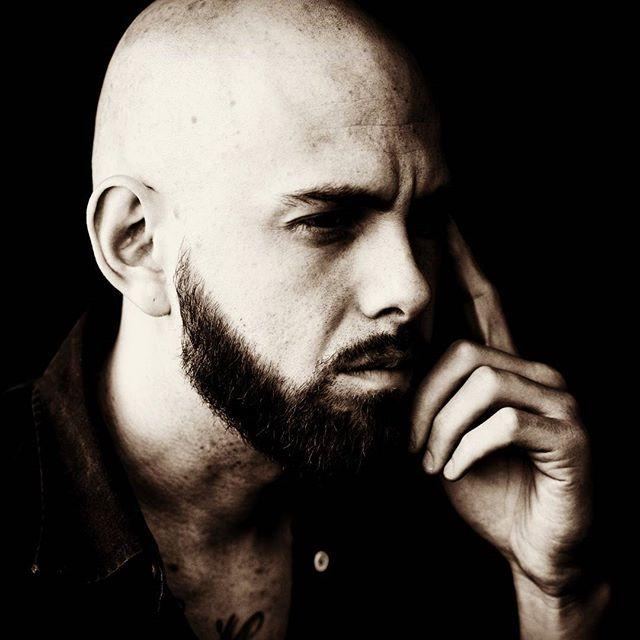 Deep in thought.  Photo Credit: @bienczycki #photography #photoshoot #photo #camera #model  #beardgang #tattoos #guyswithtattoos