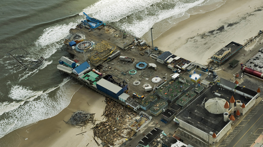 On the second day after Sandy hit the Jersey shore, I photographed this aerial view of Casino Pier showing the damaged structure and roller coaster in the ocean.