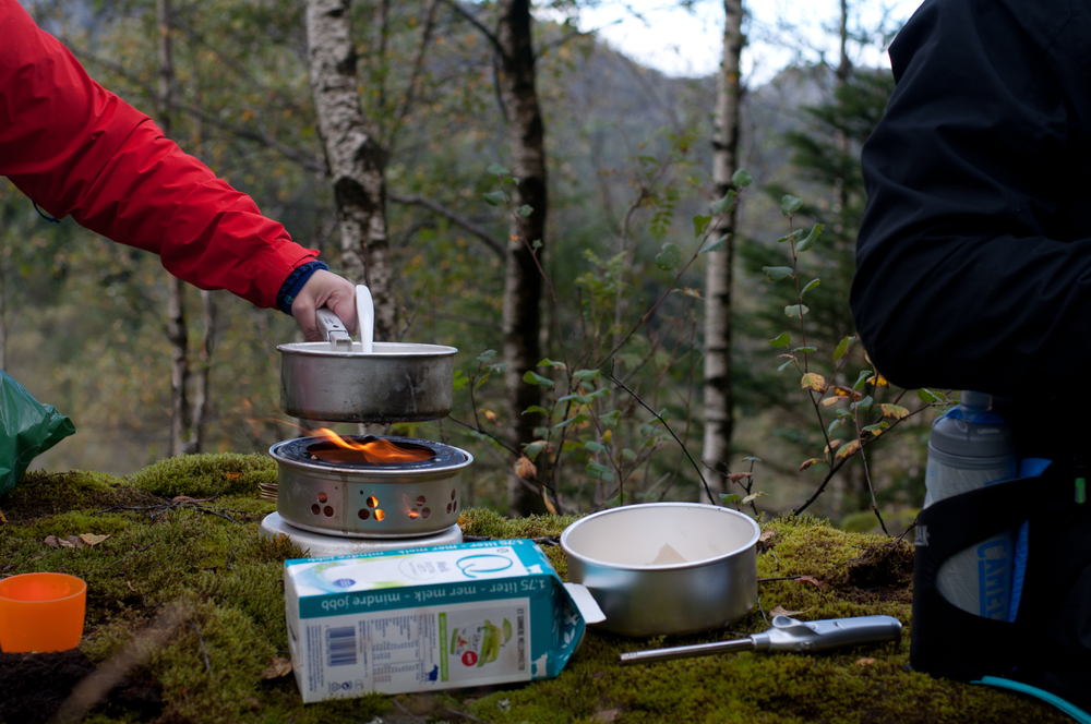 cooking oatmeal on a camping stove in norway