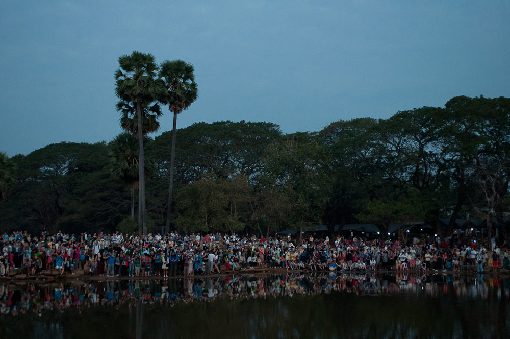 Taking the classic Angkor sunrise picture of Angkor wasn't easy standing behind the crowd, so I turned around and took their picture instead.
