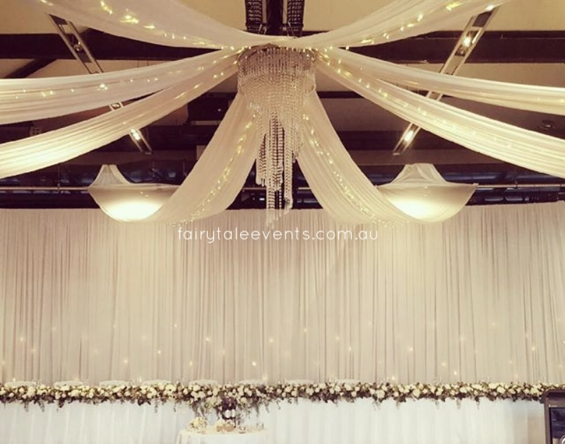 Ceiling drapes, fairy lights and chandelier at Doltone House by Fairytale Events