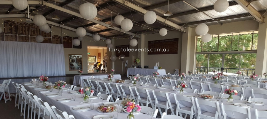White lanterns, fairy lights, backdrop & linen by Fairytale Events.
