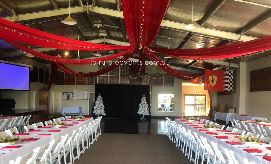 Red silk drapes, fairy lights, backdrop & linens by Fairytale Events