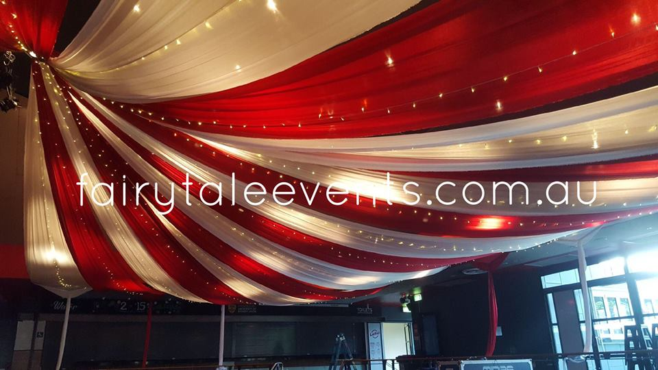 Red & white circus themed ceiling draping by Fairytale Events