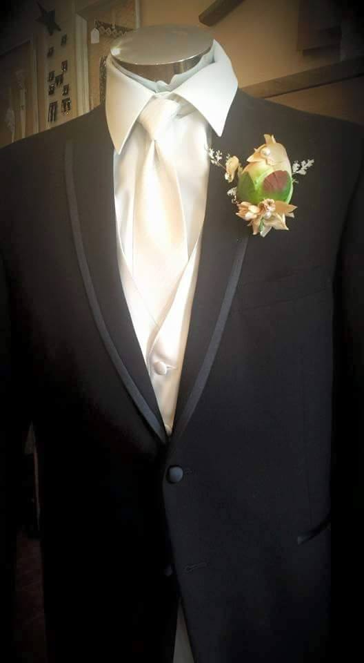 The Jherret Boutonniere is made from hand dyed and painted silk Peony bulb, single Swarovski Crystal, single antique pearl, tea-stained and hand painted Hydrangeaa Petals, mixed sprigs and rhinestone pin!