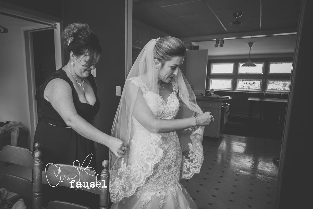 """The lace on Jess' dress stopped at 1.5"""" above her elbow so as not to compete with her dress bodice and bouquet!"""