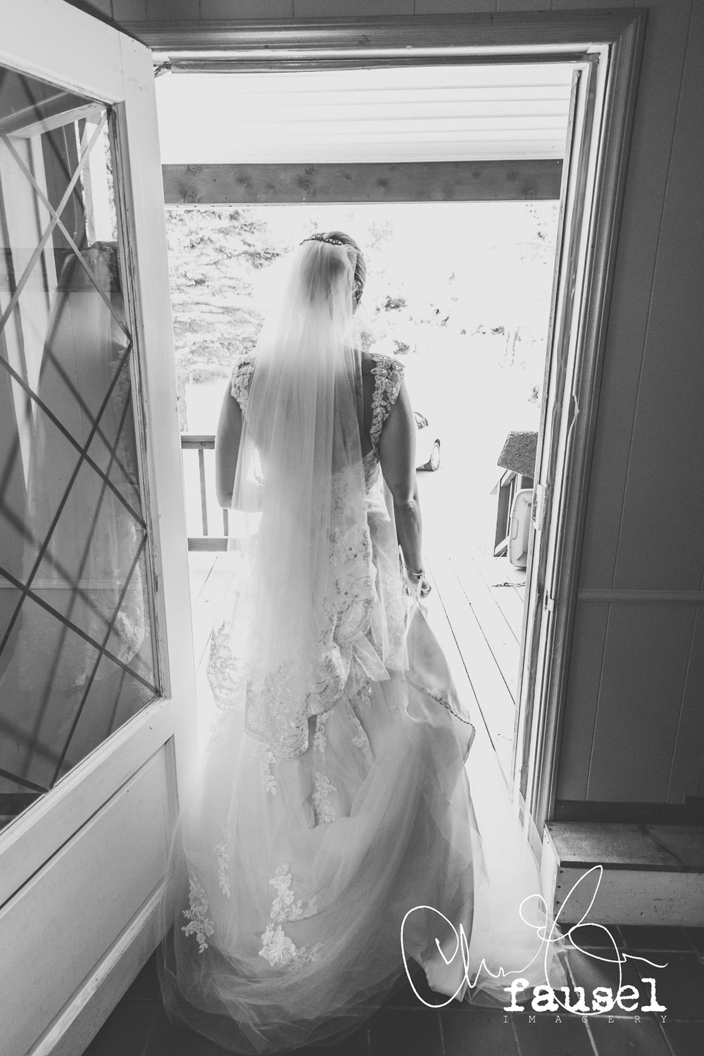 From the back the veil hit perfectly to her dresses trumpet bottom tier!
