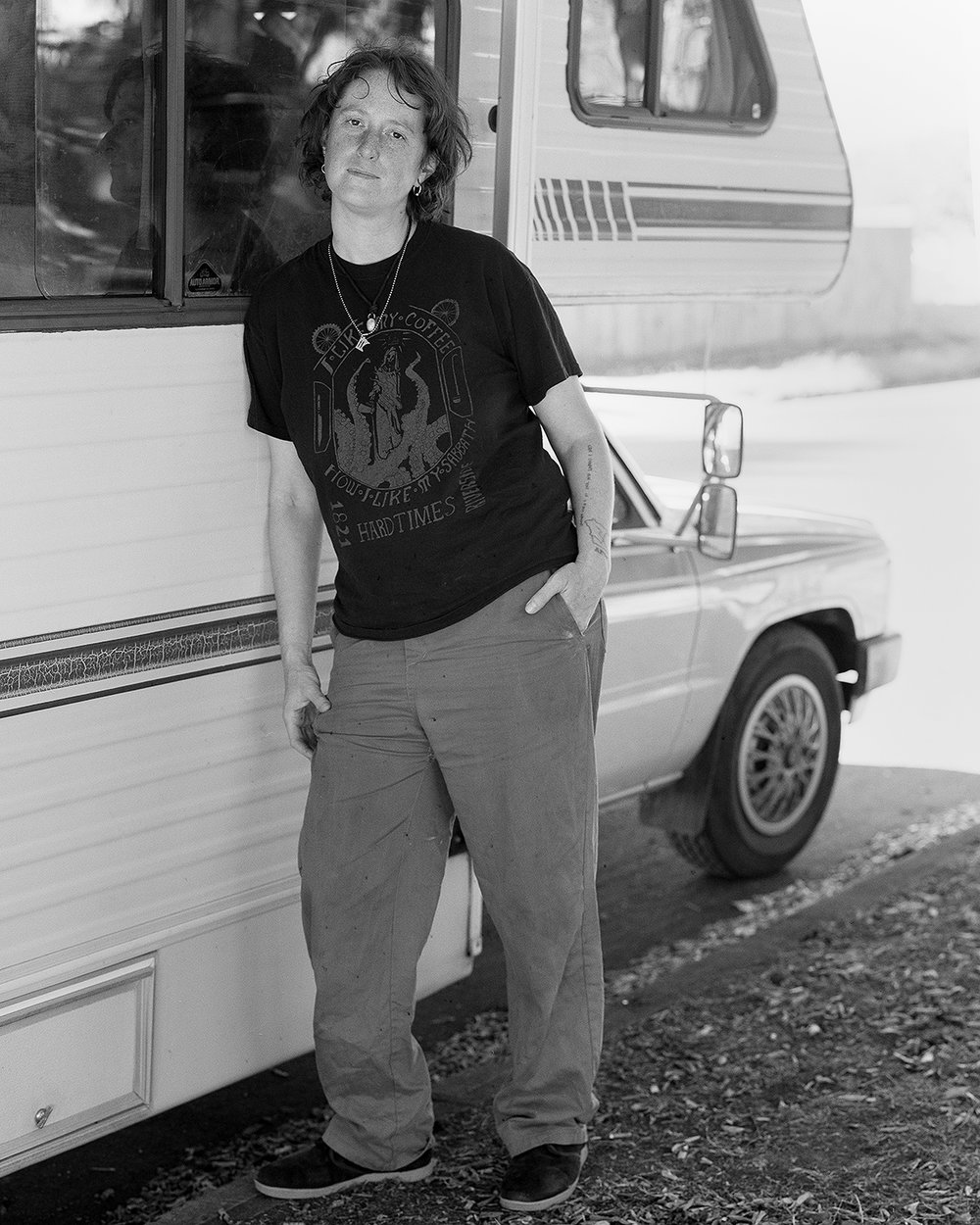 Rozina beside her RV in Portland, OR.