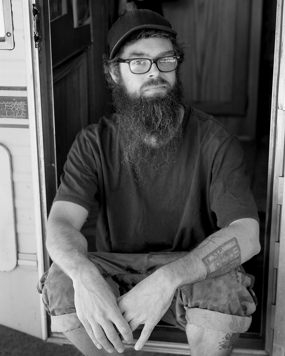 Graham in the doorway of his RV, in Portland, OR.