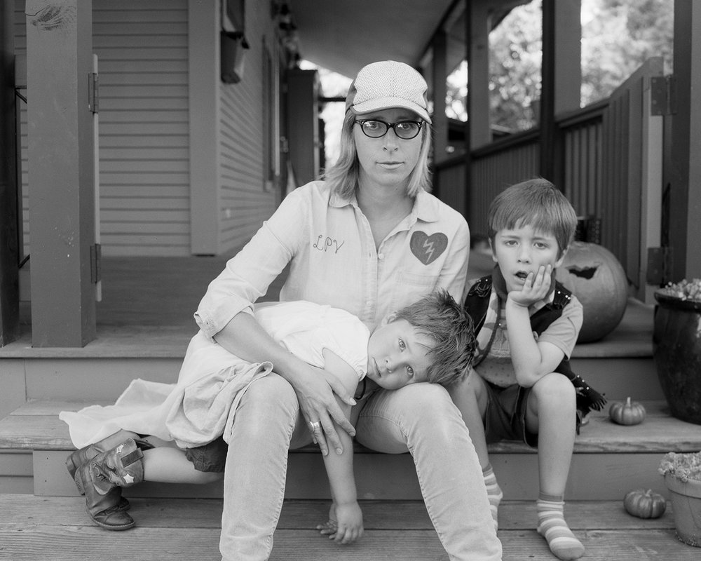 Laura and her two sons, Oz and Tennessee on their porch in Portland, OR.