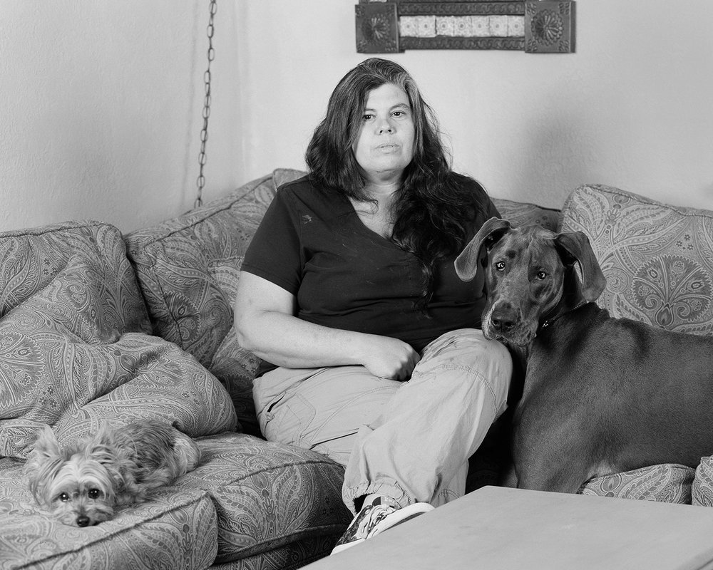 Jamie in her living room with her two dogs in Centralia, WA