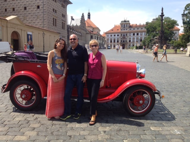 Posing with my husband and daughter in front of an entrepreneur's vintage Model A car before he gave us a personal tour of Prague highlights.