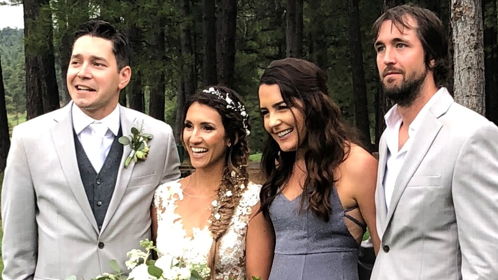 Somehow they're all 'adulting': Eric & Angela pose with daughter Cristina and fiance, Jay.