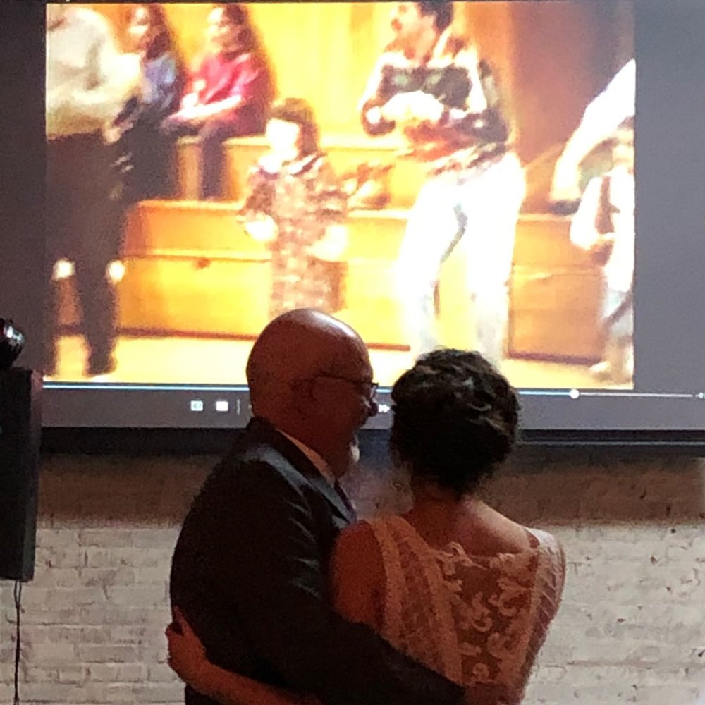 Father/Daughter Dance at the wedding while a tape from their very first one, doing the chicken dance, plays in the background.