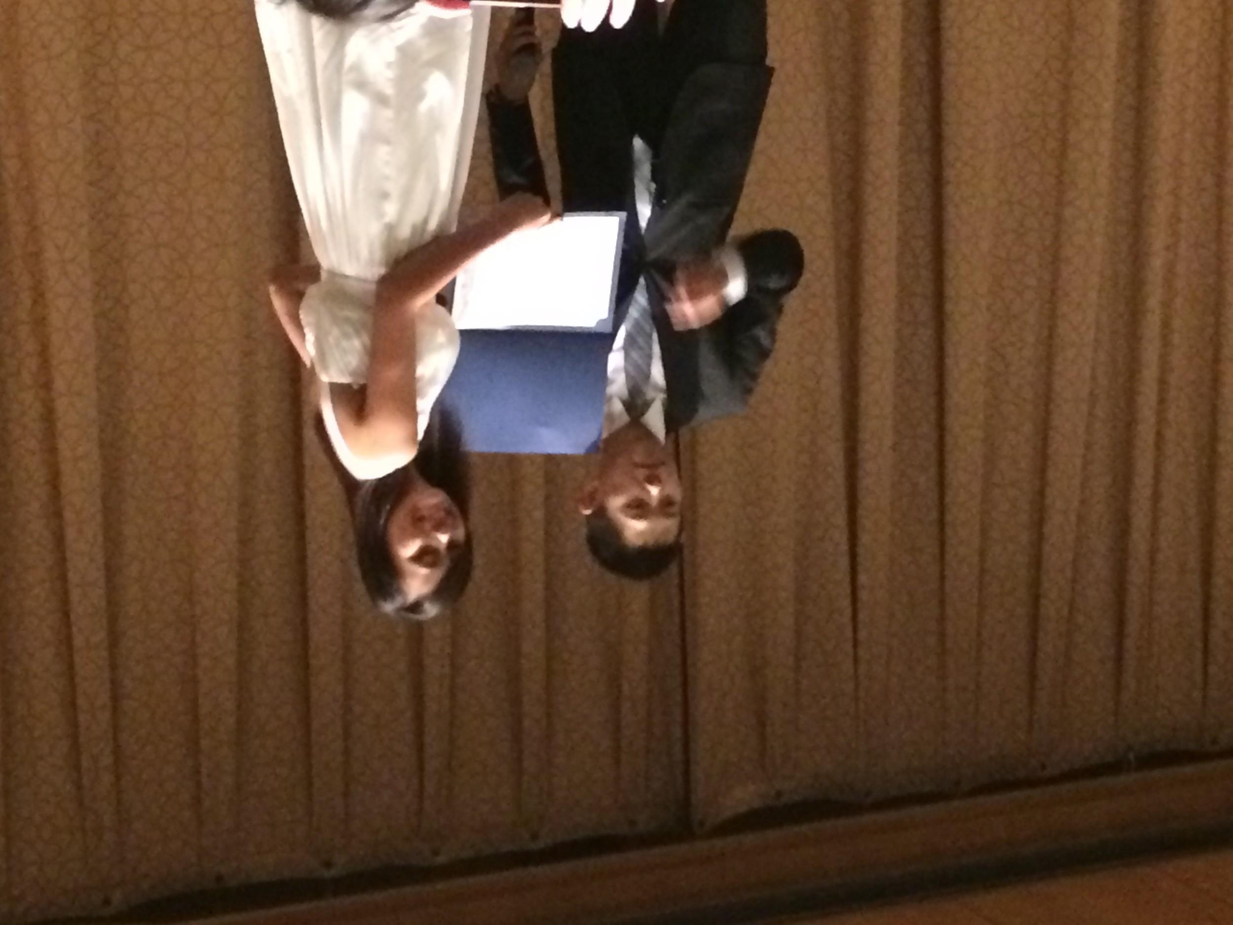 Co-Director of Outreach Gar Yeung presents 2014 Trailblazer award winner Kim Soun Ty with her award.
