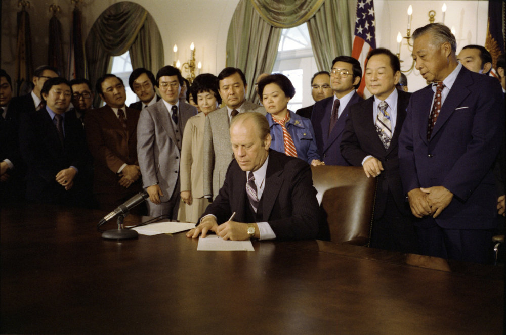 Gerald Ford signs Executive Order 4417. Photo from the White House archives.