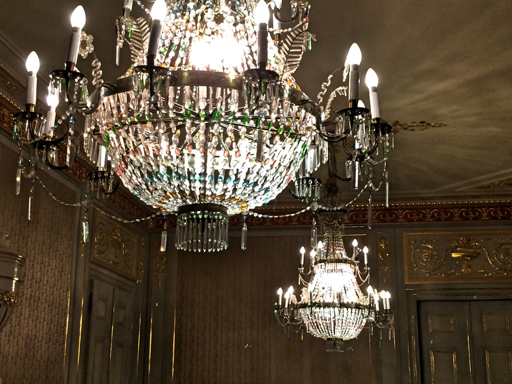 You can room a house by how many classy chandeliers are in it. This room had two...