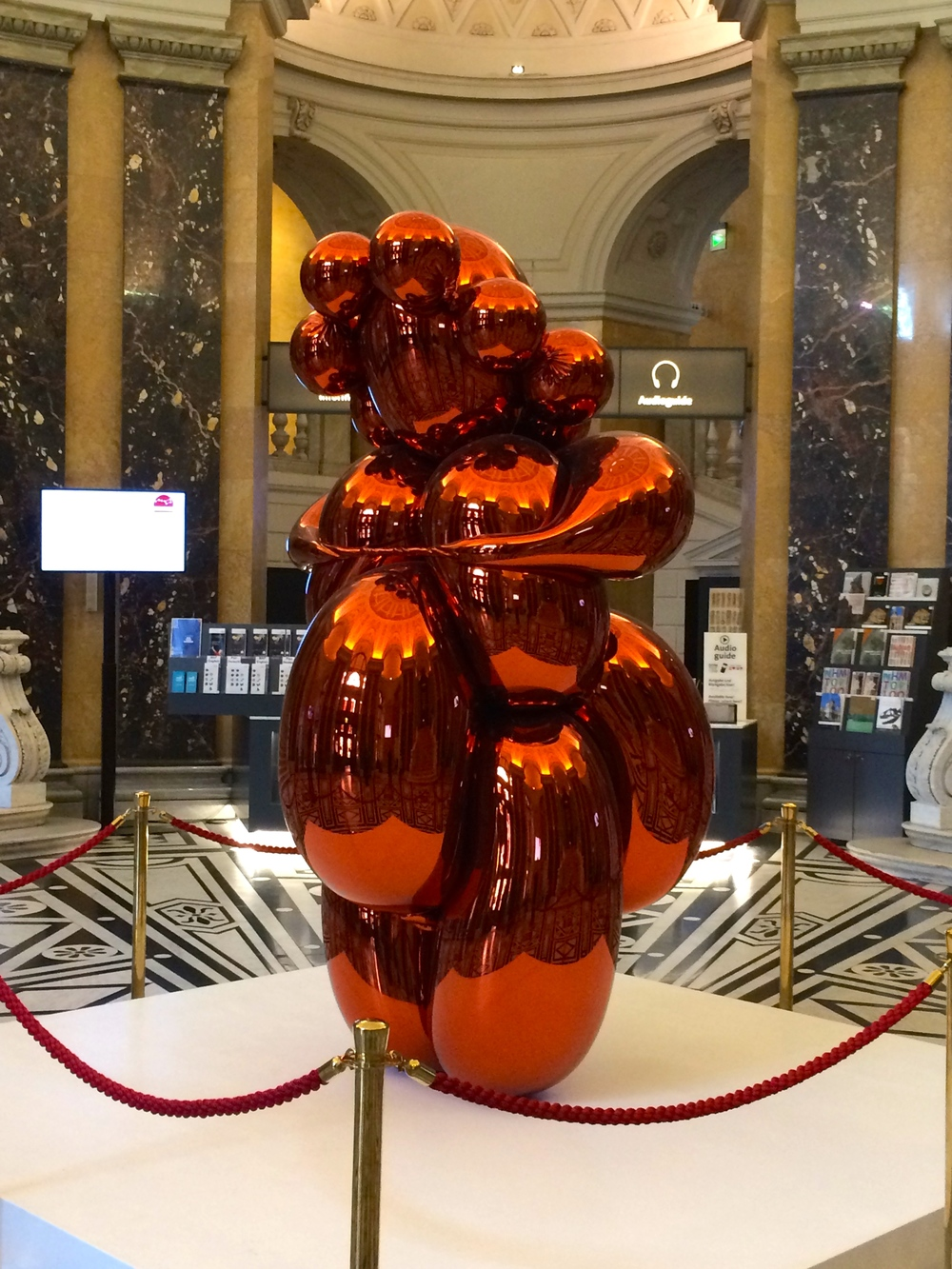 """""""How should we greet all the visitors to the museum?""""  """"Oh I know. Let's have a  balloon animal-looking statue  of our most popular item. That'll help make it relevant to the kids!"""""""